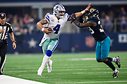 ARLINGTON, TX - OCTOBER 14:  Dak Prescott #4 of the Dallas Cowboys stiff arms and is pushed out of bounds by Tashaun Gipson Sr. #39 of the Jacksonville Jaguars at AT&T Stadium on October 14, 2018 in Arlington, Texas.  The Cowboys defeated the Jaguars 40-7.  (Photo by Wesley Hitt/Getty Images) *** Local Caption *** Dak Prescott; Tashaun Gipson Sr.