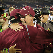 Florida State Seminoles head coach Jimbo FIsher hugs former player Jameis Winston after winning a NCAA football game between the Ole Miss Rebels and the Florida State Seminoles at Camping World Stadium on September 5, 2016 in Orlando, Florida. (Alex Menendez via AP)