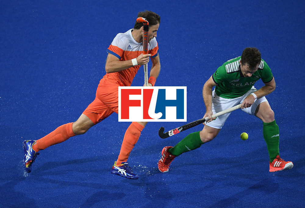 Netherland's Rogier Hofman chases Ireland's John Jackson (R) during the men's field hockey Netherlands vs Ireland match of the Rio 2016 Olympics Games at the Olympic Hockey Centre in Rio de Janeiro on August, 7 2016. / AFP / MANAN VATSYAYANA        (Photo credit should read MANAN VATSYAYANA/AFP/Getty Images)