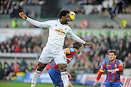 Wilfried Bony of Swansea city jumos for the ball in the goal area.<br /> Barclays Premier league match, Swansea city v Crystal Palace at the Liberty stadium in Swansea, South Wales on Saturday 29th November 2014<br /> pic by Phil Rees, Andrew Orchard sports photography.