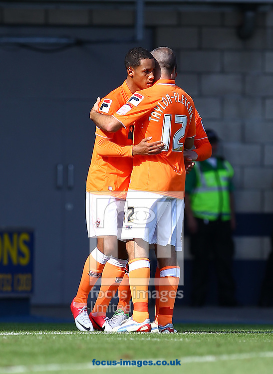 Picture by John  Rainford/Focus Images Ltd +44 7506 538356.18/08/2012.Thomas Ince of Blackpool celebrates his second goal with Gary Taylor-Fletcher during the npower Championship match at The Den, London.
