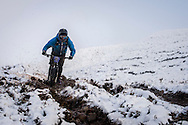 Angus Hardie spits mud as he tackles stage three of the Kinlochleven Enduro.