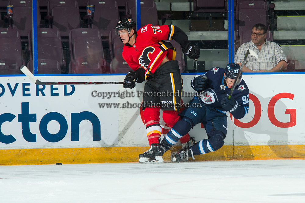 PENTICTON, CANADA - SEPTEMBER 11: Tyson Helgesen, #78 of Calgary Flames checks Kody McDonald #92 of Winnipeg Jets to the ice on September 11, 2017 at the South Okanagan Event Centre in Penticton, British Columbia, Canada.  (Photo by Marissa Baecker/Shoot the Breeze)  *** Local Caption ***