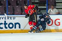 PENTICTON, CANADA - SEPTEMBER 11: Tyson Helgesen, #78 of Calgary Flames checks Kody McDonald #92 of Winnipeg Jets to the ice on September 11, 2017 at the South Okanagan Event Centre in Penticton, British Columbia, Canada.  (Photo by Marissa Baecker/Shoot the Breeze)  *** Local Caption ***