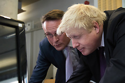 Camden City Learning Centre, London, June 15th 2015. London Mayor Boris Johnson joins future entrepreneurs at Camden City Learning Centre to launch London Technology Week and to launch a dedicated online hub for the Capital's thriving technology industry. PICTURED: Boris Jognson watches a demonstration of the London Technology Hub website.