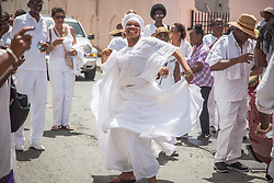 Bamboula dancer Marie Paul dances as the tour moves to Market Square.  9th Annual Dollar Fo' Dollar Culture and History Tour, a remembrance of the 1892 Coal Workers Strike on St. Thomas.  20 September 2014.  St. Thomas, USVI.  © Aisha-Zakiya Boyd