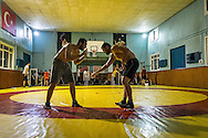 Ahmet Kiliç, left, trains with a friend during a training sessions held for both professional and hobbyist wrestlers in Istanbul. Haydarpaşa Demirspot Kulbübü