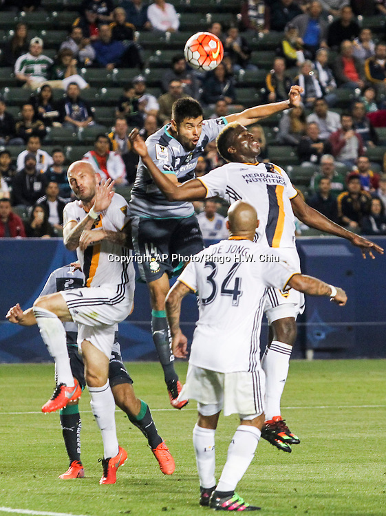 Santos Laguna's defender Nestor Araujo heads the ball against Los Angeles Galaxy during the first half of a CONCACAF Champions League quarter final game in Carson, Calif., Wednesday, Feb. 24, 2016. (AP Photo/Ringo H.W. Chiu)