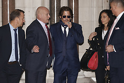 © Licensed to London News Pictures. 26/02/2020. London, UK. American Actor Johnny Depp leaves the High Court i London. Johnny Depp is in a legal dispute with a UK tabloid newspaper. Photo credit: Peter Macdiarmid/LNP