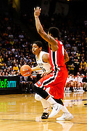 December 28th, 2013:  Colorado Buffaloes junior guard Spencer Dinwiddie (25) drives against Georgia Bulldogs sophomore guard Charles Mann (4) in the second half of the NCAA Basketball game between the Georgia Bulldogs and the University of Colorado Buffaloes at the Coors Events Center in Boulder, Colorado