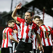 Brentford striker Lasse Vibe celebrating scoring Brentford's first goal during the Sky Bet Championship match between Brentford and Milton Keynes Dons at Griffin Park, London, England on 5 December 2015. Photo by Matthew Redman.