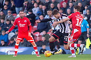 Grimsby Town forward Harry Cardwell battles with Crawley Town defender Joe Maguire during the EFL Sky Bet League 2 match between Grimsby Town FC and Crawley Town at Blundell Park, Grimsby, United Kingdom on 17 November 2018.