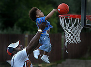 Henry Barnes takes his grandson Jaden 2, (Matt's nephew) up for a dunk in Matt Barnes backyard which has a full court. Picture was taken at Matt Barnes house during halftime of the NBA Western Conference Semifinals Warriors vs Utah. Picture taken at Matt Barnes house, May 9, 2007