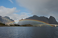 Reine, Norway.  Rainbow over bay