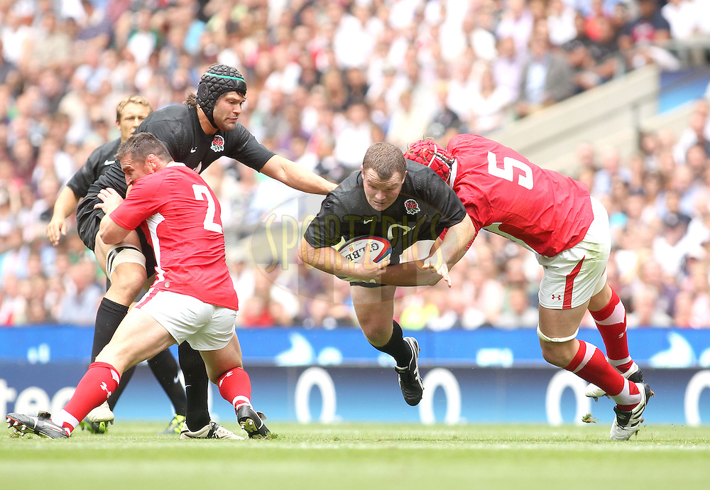 © Andrew Fosker / Seconds Left Images 2011 - England's Matt Stevens is thrown into the air by an Alun-Wyn Jones tackle - England v Wales  - Investec International - 06/08/2011 - Twickenham Stadium  - London - All rights reserved..