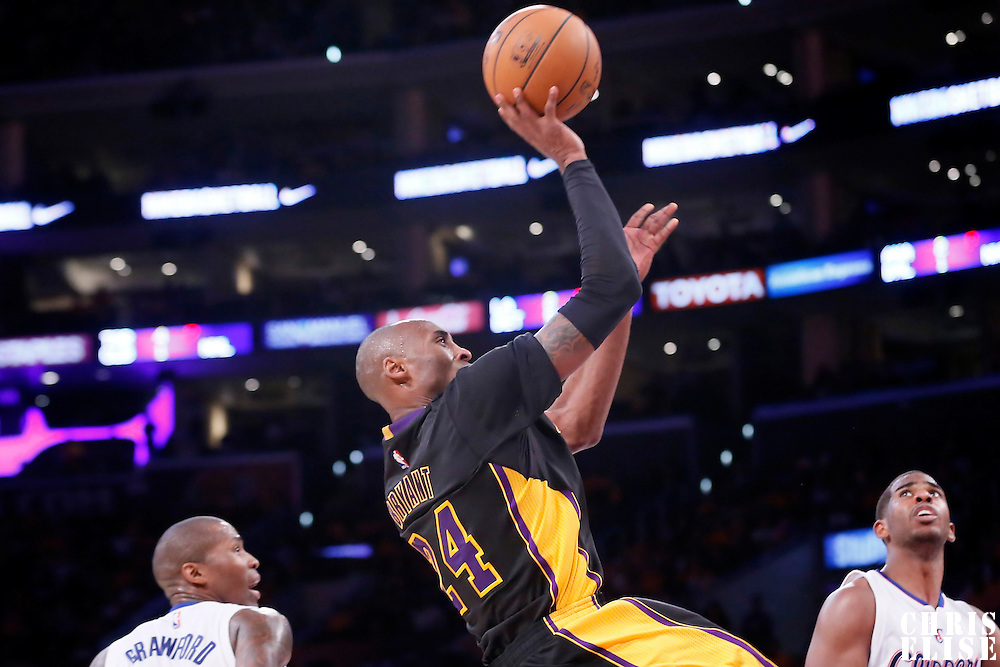 31 October 2014: Los Angeles Lakers guard Kobe Bryant (24) goes for the fade away jump shot during the Los Angeles Clippers 118-111 victory over the Los Angeles Lakers, at the Staples Center, Los Angeles, California, USA.