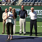 Vic Braden is honored during a ceremony on Stadium 1 at the 2015 BNP Paribas Open in Indian Wells, California on Thursday, March 19, 2015. Kris Paul at the microphone. <br />