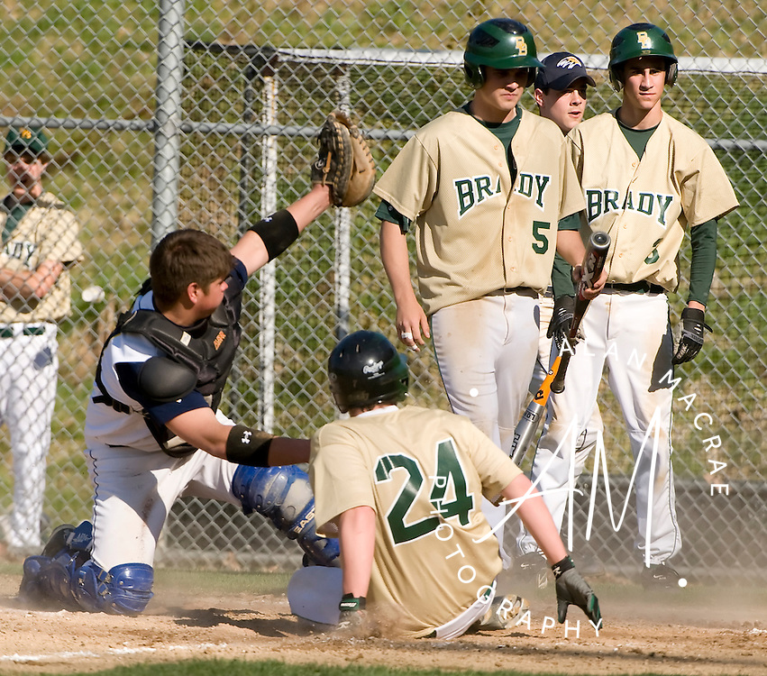Bow catcher Jim Paveglio shows the ball to the ump after getting Bishop Brady's [24-O'Brian] out at home plate in Monday's game at Bow.  (Alan MacRae/for the Monitor)