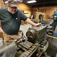 Richey Crew, owner of Richey's Gun and Archery Shop in Algoma, keeps an eye on the lathe as he machines a new muzzle brake in his gun shop for a customers order. Crew has been working with guns since 1981 and has had his shop in Algoma since 2002 and in 2008 the building became Richey's Gun Shop.