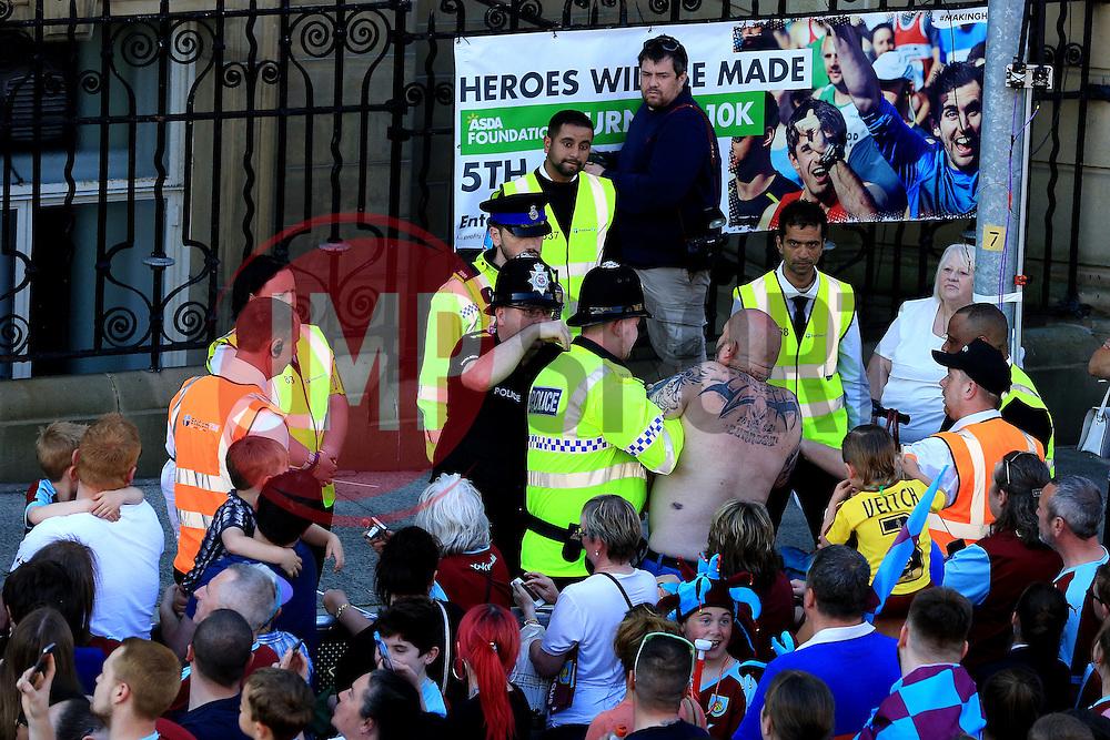 A fan is escorted away by police - Mandatory by-line: Matt McNulty/JMP - 09/05/2016 - FOOTBALL - Burnley Town Hall - Burnley, England - Burnley FC Championship Trophy Presentation