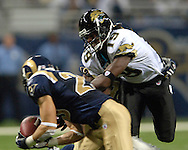 St. Louis Rams safety Mike Furrey (25) intercepts the pass in front of Jacksonville wide receiver Ernest Wilford (19) in the fourth quarter at the Edward Jones Dome in St. Louis, Missouri, October 30, 2005.  The Rams beat the Jaguars 24-21.