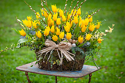 Basket of yellow tulips. Designed by Jonathan Moseley