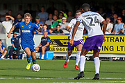 AFC Wimbledon midfielder Max Sanders (23) dribbling and taking on Shrewsbury Town defender Ethan Ebanks-Landell (24)and Shrewsbury Town defender Donald Love (17) during the EFL Sky Bet League 1 match between AFC Wimbledon and Shrewsbury Town at the Cherry Red Records Stadium, Kingston, England on 14 September 2019.