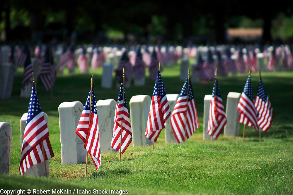 IDAHO. Boise. Morris Hill Cemetery, Silent Camp. Flags on military gravestones on Memorial Day. May 2006 #hm060108