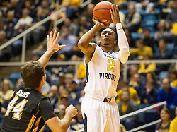 Nov 13, 2015; Morgantown, WV, USA; West Virginia Mountaineers guard Jevon Carter shoots a three during the first half against the Northern Kentucky Norse at WVU Coliseum. Mandatory Credit: Ben Queen-USA TODAY Sports