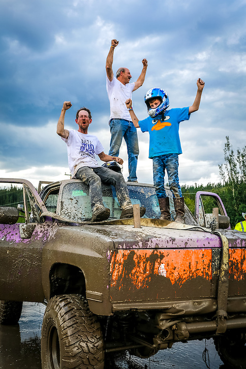 TNT's crew celebrate after winning the medium tire class at the Whitehorse Mud Bogs.