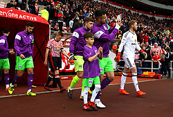 Bailey Wright of Bristol City with mascot they lead the side out at Sunderland - Mandatory by-line: Robbie Stephenson/JMP - 28/10/2017 - FOOTBALL - Stadium of Light - Sunderland, England - Sunderland v Bristol City - Sky Bet Championship
