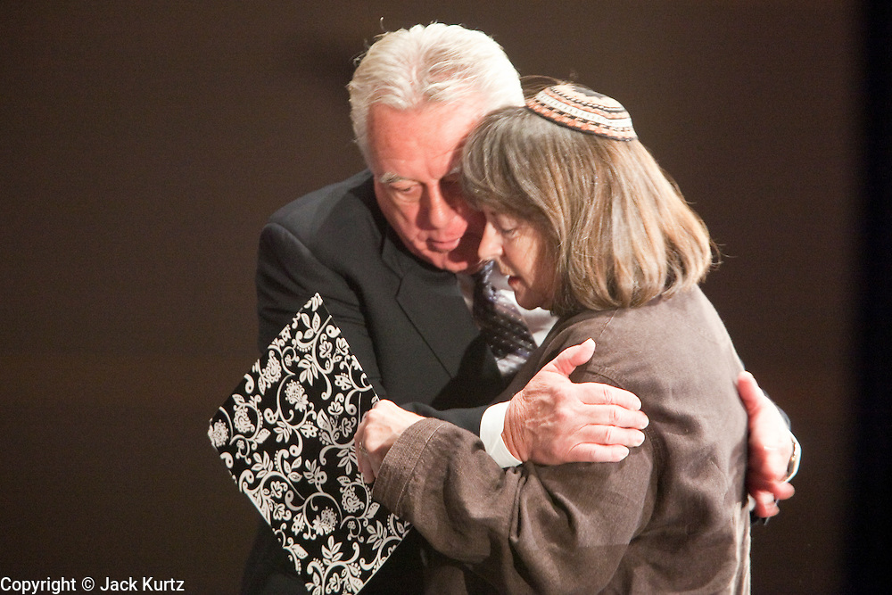 tucsonshooting - 11 JANUARY 2011 - TUCSON, AZ: Jack Camper, left, (CQ) hugs Rabbi Stephanie Aaron (CQ) after Aaron said a prayer for the victims of the mass shooting in Tucson. Aaron is Gabrielle Giffords' rabbi. They were at the Governor's appearance in Tucson.  ARIZONA REPUBLIC PHOTO BY JACK KURTZ mass shooting Gabrielle Giffords shooting