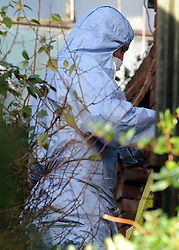 © Licensed to London News Pictures. 05/01/2016<br /> Police forensics officer at the side of the property in the backgarden searching.<br /> <br /> Sian Blake's home in Erith,Kent has turned into a crime scene today (05.01.2016) with officers from the Met's Homicide and Major Crime Command leading the search for the missing family.<br /> Police teams at the home of missing EX-EastEnders actress SIAN BLAKE who has been missing along with her Boyfriend and two sons since early December 2015.<br /> (Byline:Grant Falvey/LNP)