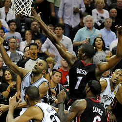 Jun 13, 2013; San Antonio, TX, USA; San Antonio Spurs point guard Tony Parker (9) shoots against Miami Heat center Chris Bosh (1) during the third quarter of game four of the 2013 NBA Finals at the AT&T Center. Mandatory Credit: Derick E. Hingle-USA TODAY Sports