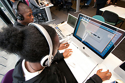 Teenage boys in a summer holiday class in digital music Haringey London UK
