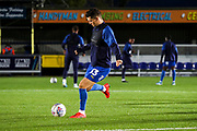 AFC Wimbledon midfielder Callum Reilly (33) warming up during the Leasing.com EFL Trophy match between AFC Wimbledon and Leyton Orient at the Cherry Red Records Stadium, Kingston, England on 8 October 2019.