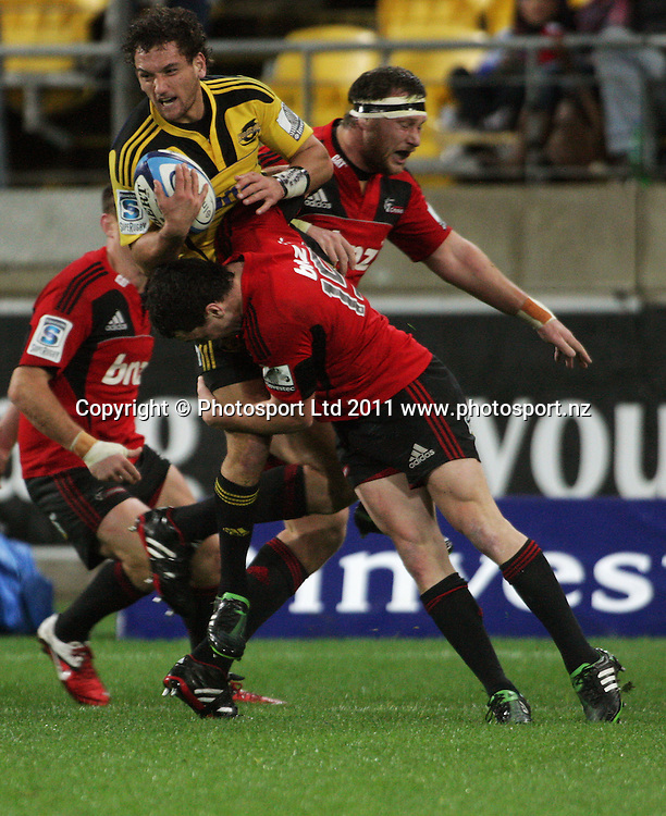 Tom Marshall tackles Aaron Cruden. Super 15 rugby match - Crusaders v Hurricanes at Westpac Stadium, Wellington, New Zealand on Saturday, 18 June 2011. Photo: Dave Lintott / photosport.co.nz