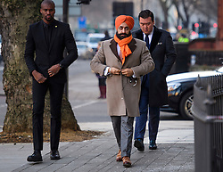 © Licensed to London News Pictures. 18/01/2017. London, UK. Conservative Party donor and Businessman PETER SINGH VIRDEE (centre), flanked by security guards as he arrives at Westminster Magistrates Court in London where he faces extradition to Germany. Mr Virdee, who was arrested at Heathrow airport, is accused by German prosecutors of being part of a criminal enterprise to defraud the authorities of €125m (£109m) of VAT on carbon credits under the EU Emissions Trading Scheme. Photo credit: Ben Cawthra/LNP