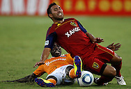HOUSTON, TX - AUGUST 20: Arturo Alvarez #10 of Real Salt Lake is tackled by Je-Vaughn Watson #10 of the Houston Dynamo at Robertson Stadium on August 20, 2011 in Houston, Texas.