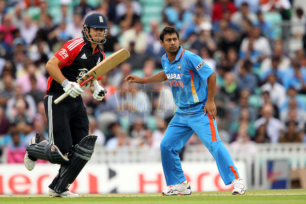 England's Alistair Cook and India's Praveen Kumar during the 3rd One Day International ( ODI ) between England and India held at the Kia Oval in London, England on the 9th September 2011...Photo by Ron Gaunt/SPORTZPICS/BCCI