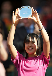 LONDON, ENGLAND - Saturday, July 3rd, 2010: Sachie Ishizu (JPN) with the Girls' Singles runner-up trophy on day twelve of the Wimbledon Lawn Tennis Championships at the All England Lawn Tennis and Croquet Club. (Pic by David Rawcliffe/Propaganda)