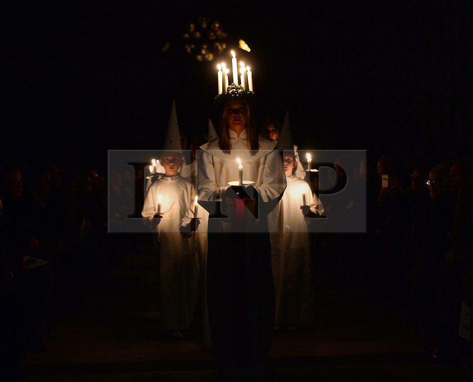 © Licensed to London News Pictures. 11/12/2015. York, UK. Sara Kjorling from Stockholm leads the procession during the Sankta Lucia Carol Service at York Minster. Lucia is a tradition in the Swedish calendar and is a celebration of St Lucy as the bringer of light in the darkness of winter.  Photo credit : Anna Gowthorpe/LNP