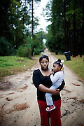 "Lettorea ""Lottie"" Clark, 25 and her daughter Gabby, 2, outside their apartment in Albany, GA on Friday, October 24, 2008. Lottie and Gabby live off welfare after escaping an abusive relationship with Gabby's father."