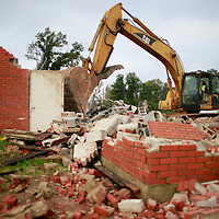 Thomas Wells | BUY AT PHOTOS.DJOURNAL.COM<br /> Tupelo Public Works employee Dennis Carr finishes tearing down what was left of the old Fire Station #4 off North Gloster on Wednesday that was heavily damaged in the April 28, 2014 tornado.