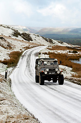 © Licensed to London News Pictures. 28/01/2020. Howey, Powys, Wales, UK.A four-wheel-drive vehicle negotiates a road in a wintry landscape near Howey in Powys, Wales, UK. Photo credit: Graham M. Lawrence/LNP