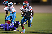 Bernard Goodwater (29) of the Carter Cowboys rushes for a touchdown against the Lincoln Tigers during a high school football game at Forester Stadium in Dallas, Texas on September 18, 2015. (Cooper Neill/Special Contributor)