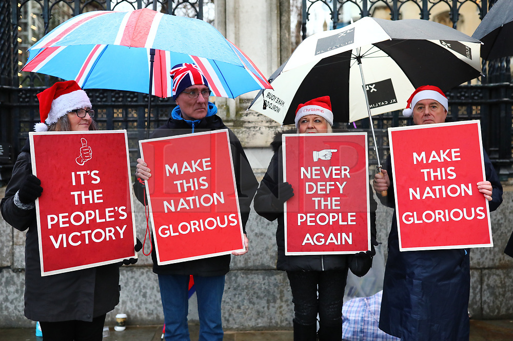 © Licensed to London News Pictures. 20/12/2019. London, UK. Brexit supporters wait outside Parliament as MPs vote on the Withdrawal Agreement Bill. Photo credit: Rob Pinney/LNP