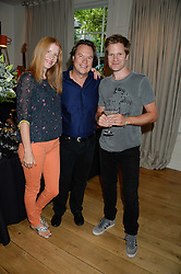 Left to right, MARTHA BROWN, JOHN HITCHCOX and DOMINIC BROWN guitarist in Duran Duran at an Evening with Notting Hill Guitars held at 167 Westbourne Grove, London W11 on 4th September 2013.