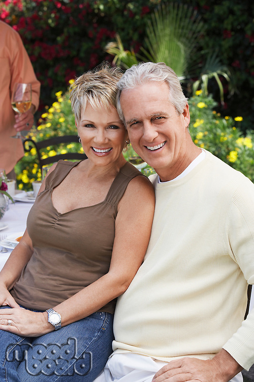 Smiling Couple Relaxing Outdoors