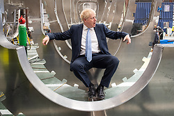 Conservative party leadership contender Boris Johnson sits inside a boat under construction at the Wight Shipyard Company at Venture Quay during a visit to the Isle of Wight.